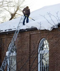 A worker cleared snow yesterday from the roof of Saint Luke United Methodist Church in northwest Washington, D.C.