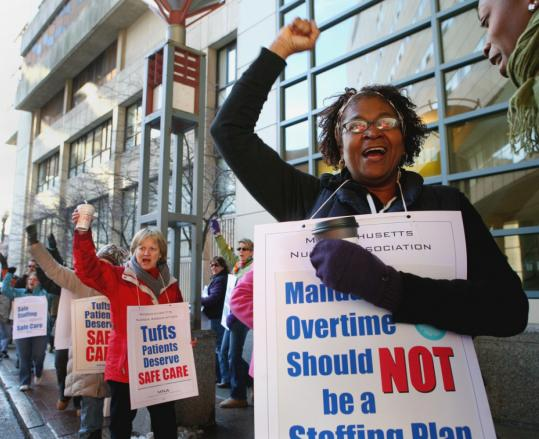 Nerrissa Shurtluff and others gathered outside Tufts Medical Center in Boston. Nurses from Tufts and Boston Medical Center protested what they say are dangerous changes to staffing.
