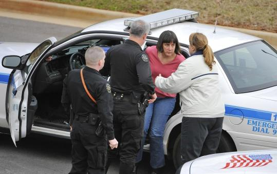Police detained a woman yesterday after the shooting. The NBC affiliate in Huntsville, Ala., quoted school officials as saying the alleged suspect began shooting after learning at the faculty meeting that she was being denied tenure.