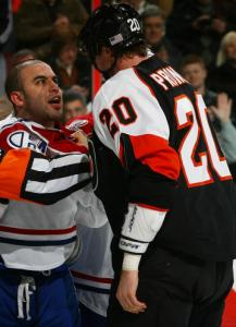 Tempers flare between Montreal's Scott Gomez (left) and Flyer Chris Pronger.