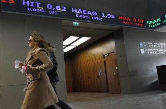 Two women walked inside the Athens stock exchange Friday. Greece has become the epicenter of global financial anxiety.