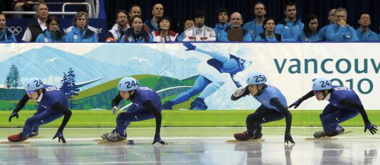 Apolo Anton Ohno (second from right) keeps up with a trio of South Koreans (from left) Lee Jung Su, Sung Si Bak, and Lee Ho Suk in the 1,500-meter final.