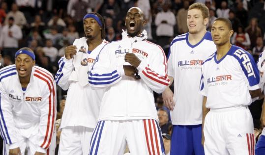 Celtics Kevin Garnett (center) and Paul Pierce (left) and their Eastern Conference teammates enjoyed the final minutes.