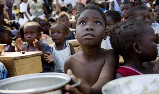 Children at a food distribution point at a camp in Jacmel, Haiti. The Jan. 12 earthquake has killed an estimated 200,000, with the total continuing to climb.