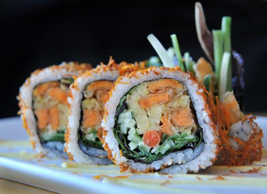 The flaming maki - filled with greens, sweet omelet, and cucumber tossed with a gingery sauce - is wrapped in rice and rolled in fried, shredded sweet potato.