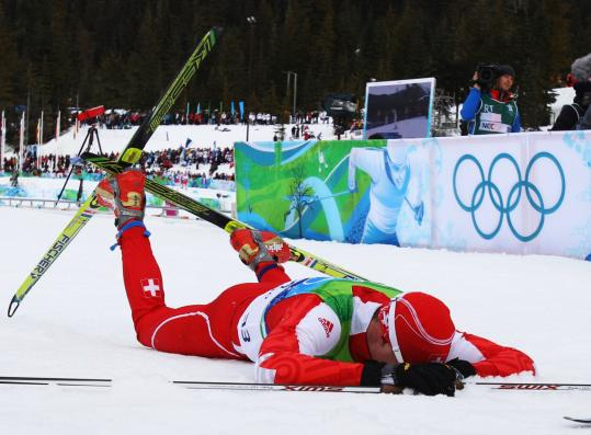 Dario Cologna takes a moment to soak in the moment provided by winning the 15k freestyle.