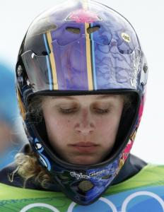 Lindsey Jacobellis, the most decorated female in her sport, cruised into the semifinals but hit a gate and finished fifth.