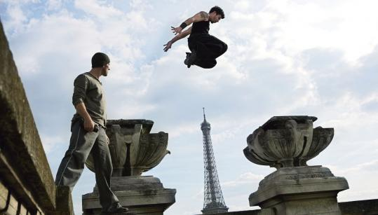 "David Belle and Cyril Raffaelli are reunited in ""District 13: Ultimatum'' to save residents of a housing project from a government conspiracy."