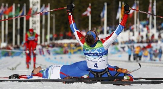 Michael Dalder/reuters Russia&#8217;s Nikita Kriukov (4) celebrates his classic victory beside Alexander Panzhinskiy.