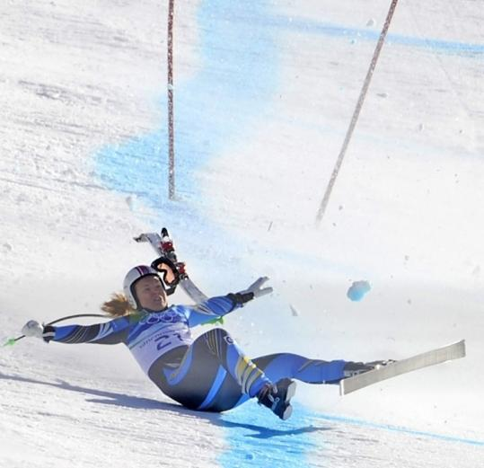 Sweden's Anja Paerson tumbled near the finish, one of many crashes that marred the women's downhill race yesterday.