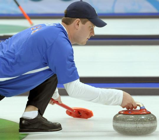 Skip John Shuster throws the stone against Switzerland, but he couldn't convert in the 11th end and the United States dropped its third straight match.