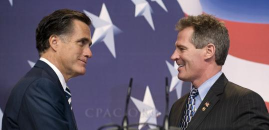 Former Massachusetts governor Mitt Romney was welcomed onstage at the Conservative Political Action Conference yesterday by the state's new Republican US senator, Scott Brown.