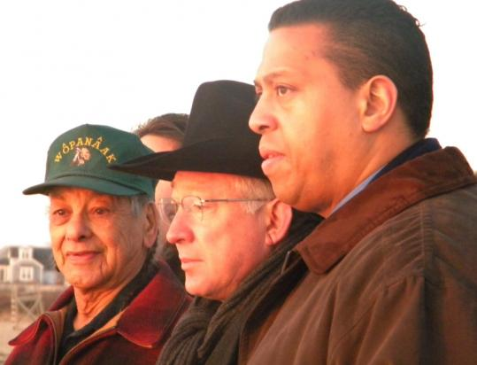 Interior Secretary Ken Salazar (center) joined Wampanoag leaders at sunrise on Feb. 2 for what they called a traditional rite. One Aquinnah Wampanoag member has questioned the authenticity of that rite.