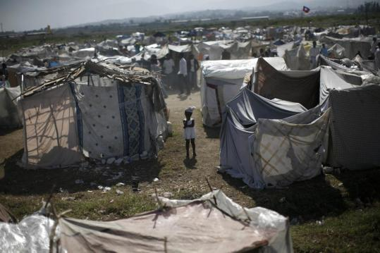A young resident of a refugee camp in Port-au-Prince stood amid a sea of the makeshift tents that aid officials say will offer little shelter during the upcoming rainy season.