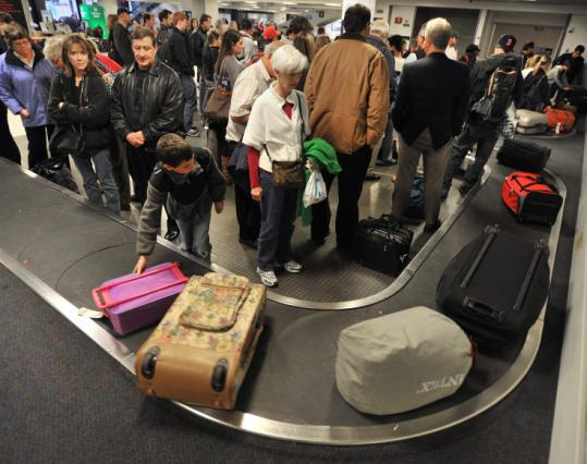 Logan airport's baggage claim at terminal C.