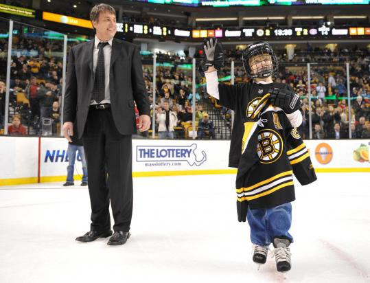 Jack Dolan, whose mother has been diagnosed with cancer, skated onto the ice at the TD Garden with former Bruin Cam Neely earlier this month. Neely invited Dolan to the Garden to honor him for raising money for a skate-a-thon charity event.