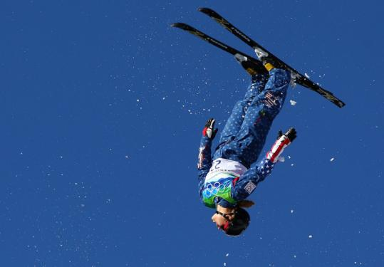American Ashley Caldwell got enough hang time to finish 12th and move on to the finals of the women's aerials.