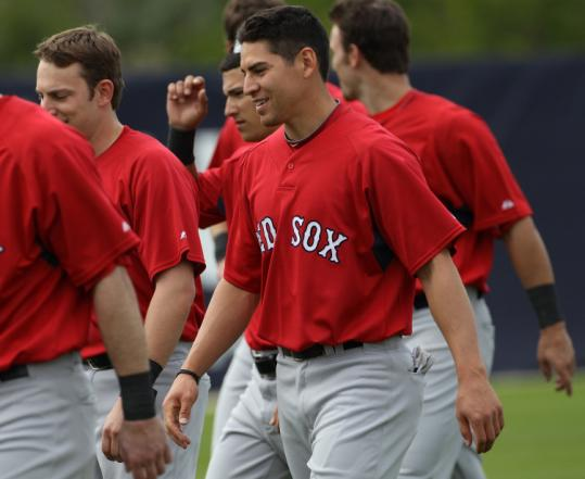 Jacoby Ellsbury works out yesterday; he believes his switch from center field to left field will work out, too.