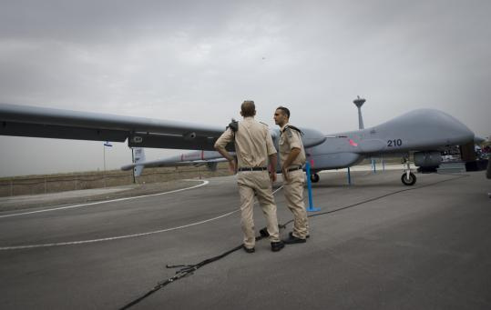 Israeli soldiers were dwarfed standing next to one of the new Heron TP surveillance drones, which have a wingspan of 86 feet and can fly at least 20 consecutive hours.