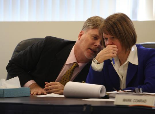 Massachusetts Parole Board members Roger Michel and Candace Kochin conferred during a hearing this month on whether to grant parole to a man convicted of a 1973 murder.