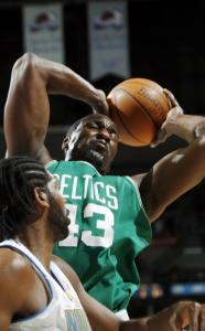 Celtics center Kendrick Perkins is determined to pull this rebound away from the Nuggets' Nene in the first quarter.