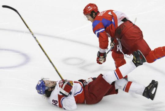 Alexander Ovechkin's thunderous hit on Jaromir Jagr sparked the Russians to a win and berth in the quarterfinals.