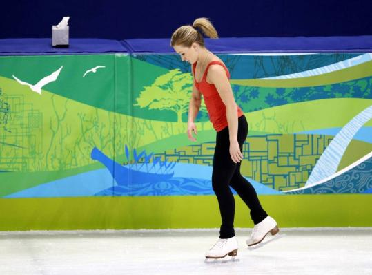 Canadian figure skater Joannie Rochette found some quiet time on the practice ice hours after the death of her mother, Therese.
