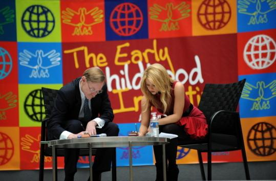 NEW DEAL - World Bank president Robert Zoellick and recording artist Shakira Mebarak signed agreements in Washington yesterday to launch early-childhood development programs in Latin America and the Caribbean.