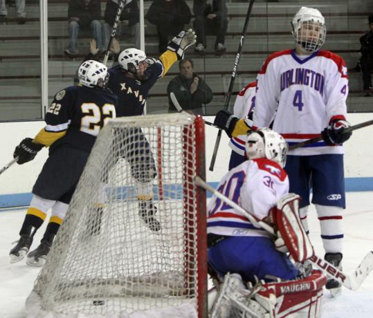 Chris Kennedy and Kevin Aufiero (22) celebrate after Kennedy's power-play goal gave Xaverian a 1-0 lead in the first period.