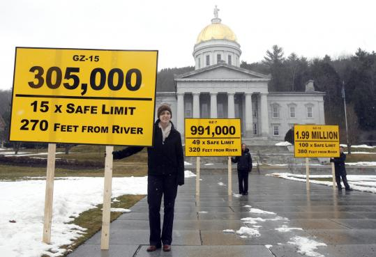 Members of the Toxics Action Center protested outside the State House in Montpelier yesterday with signs representing the monitoring wells at the Vermont Yankee nuclear plant that has been contaminated by tritium leaks.