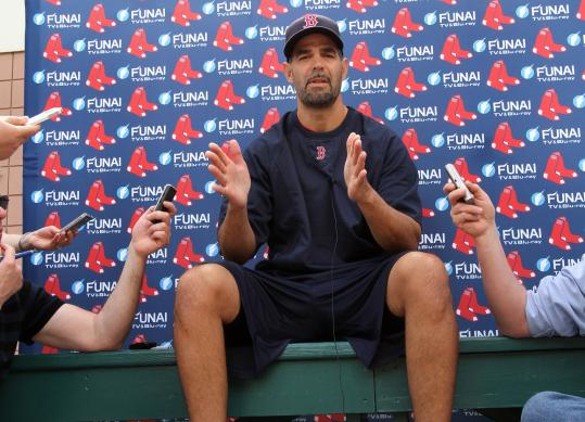 Mike Lowell and the Red Sox haven't quite come together yet on what his role will be, or