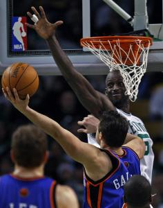New York's Danillo Gallinani was called for an offensive foul as he goes up for 2, but pushes off on Kevin Garnett.