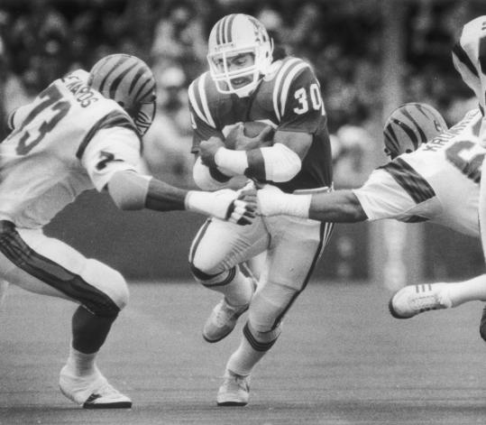 Mosi Tatupu fought for extra yardage after a long gain in 1984 against the Cincinnati Bengals. He was selected to the Pro Bowl in 1986 for his excellence on special teams.