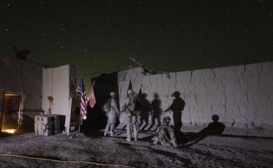 US Marines gathered outside a combat outpost before a night mission in Afghanistan's Helmand Province in October. A UN report said 98 civilians were killed during night raids in 2009.
