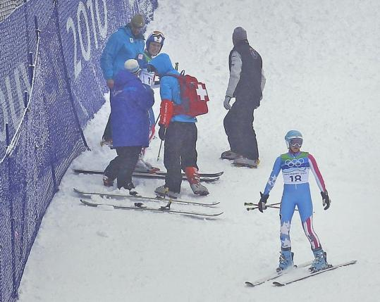 With Lindsey Vonn still on the course receiving medical attention, US teammate Julia Mancuso (right) had to do her run over.