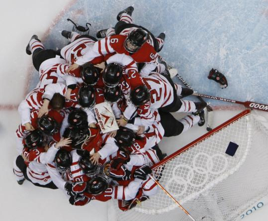 Team Canada protected their goal all night, then celebrated there when the game was over.