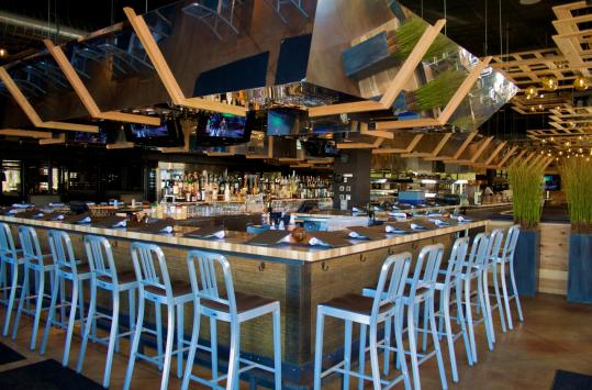 The Legal C Bar, a Legal Sea Foods offshoot at Dedham's Legacy Place, simmers with contemporary styling.