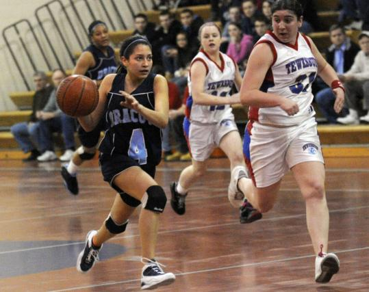 Dracut High sophomore Jamy Marquez (4) drives the ball up court against Tewksbury.