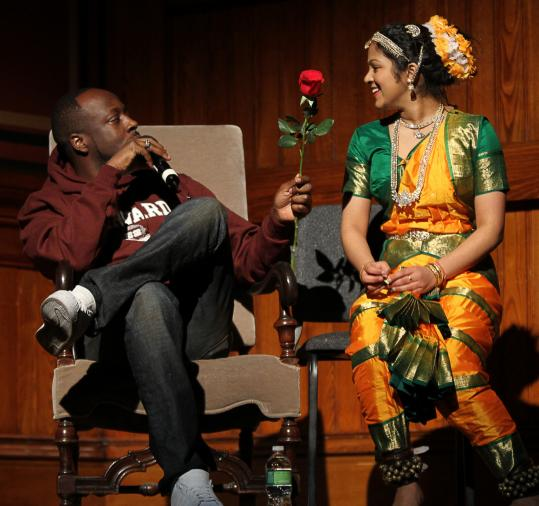 Wyclef Jean shared a moment with a member of an Indian dance troupe.