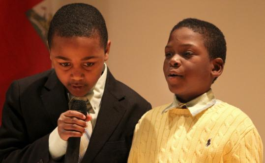 Sebastien Francois (left) and Landini Jean Louis recited a poem at the Mildred Avenue Middle School in Mattapan.