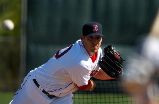 John Lackey, one of three Red Sox pitchers who have won the deciding game of a World Series, throws BP yesterday.