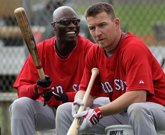 Mike Cameron (left) doesn't seem concerned with his sore groin while waiting to take batting practice with J.D. Drew.