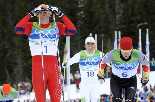 Norway's Petter Northug (1) used his trademark sprint speed to pass Germany's Axel Teichmann (6) on the final stretch.