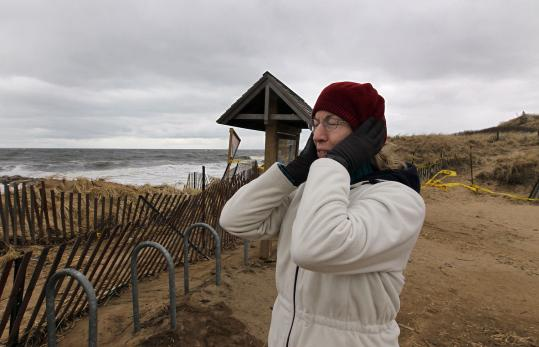 Sharon Binelli braved the wind and cold yesterday on Plum Island, near new erosion along Northern Boulevard.