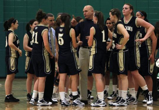 Jim Bancroft talks to his team Wednesday as it played Coyle & Cassidy. At right, Val Driscoll looks to shoot.