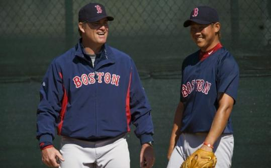 Red Sox pitching coach John Farrell (left) already likes what he has seen this spring from Daisuke Matsuzaka.