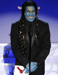 "Ben Stiller, dressed as a character from ""Avatar,'' presents the award for best makeup."