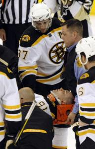 Patrice Bergeron, no stranger to concussions, talks to Marc Savard as he is taken off after a brutal hit to the head.