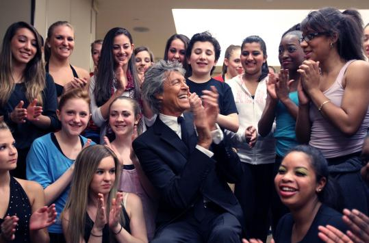 Tommy Tune is surrounded by dancers from Boston Youth Moves before he's honored at a benefit Saturday night at the Westin Copley.