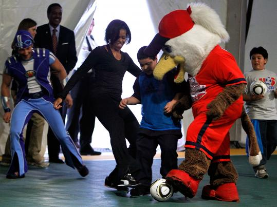 First lady Michelle Obama participates in a youth soccer clinic in Washington, D.C. Her Let's Move campaign encourages children to get active play each day and eat healthier.